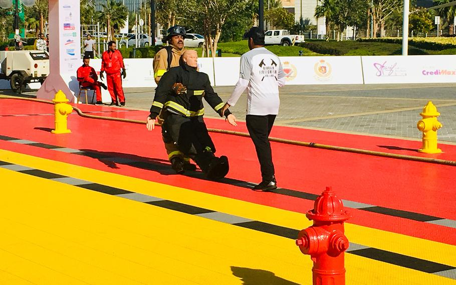 A firefighter with Naval Support Activity Bahrain Fire Department participates in the dragging event during a relay race as part of the Bahrain Firefighter Challenge on Saturday, March 2, 2019.
