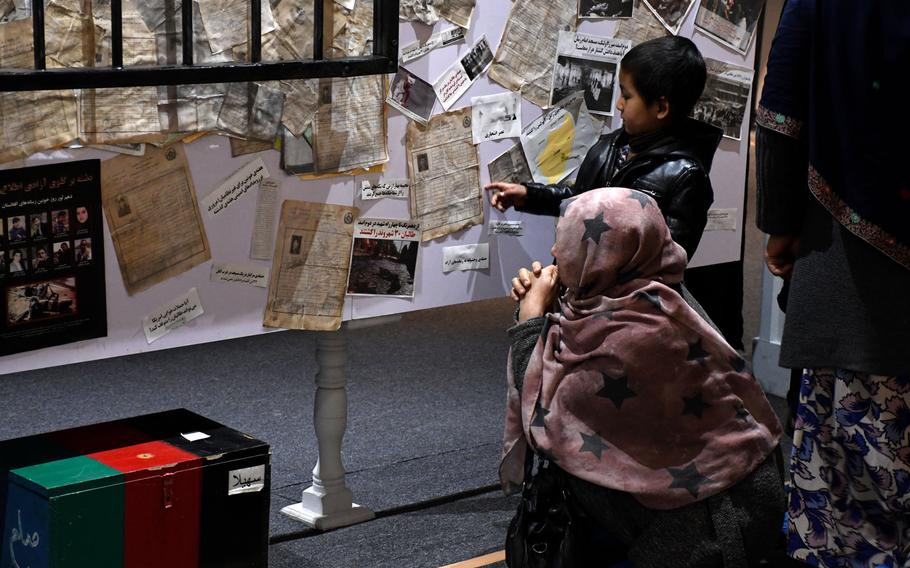 A mother and son visit the newly opened Center for Memory and Dialogue in Kabul on Feb. 27, 2019. The Center honors the memory of Afghans killed during the past four decades of violence in the country.