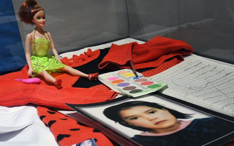 The memory box of a young Afghan War victim includes a doll she played with before she was killed. The box was on display at the Center for Memory and Dialogue in Kabul on Feb. 20, 2019.