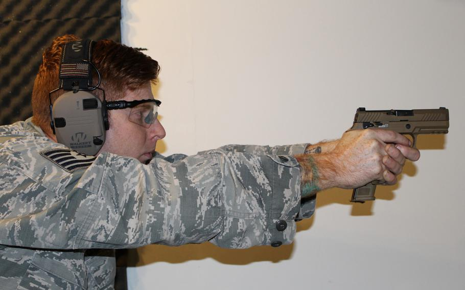 Tech. Sgt. Brady Craddock, Air Force Gunsmith Shop noncommissioned officer in charge, fires an M18 handgun. The Air Force Security Forces Center, in partnership with the Air Force Small Arms Program Office, began fielding the new M18 Modular Handgun System to all security forces units.