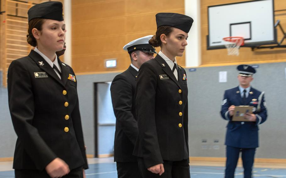 Members of the Naples drill team participate in the unarmed regulation competition during the DODEA-Europe JROTC drill team championships at Ramstein, Germany, Saturday, March 2, 2019. More than 100 cadets from 11 JROTC drill teams participated in the competition.