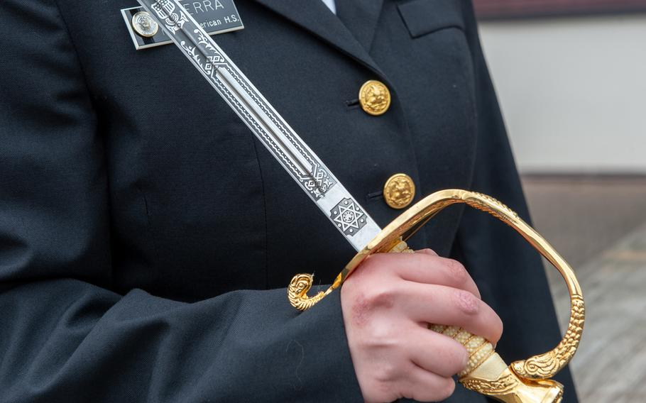 Nubia Guerra, Naples, hold her saber at the DODEA-Europe JROTC drill team championships at Ramstein, Germany, Saturday, March 2, 2019.