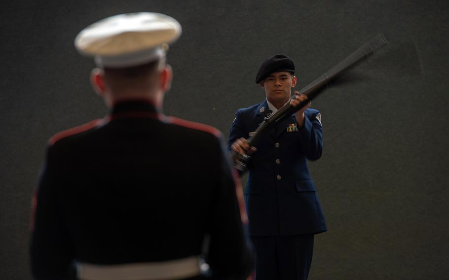 Gunnery Sgt. Matthew Nolan watches as Brandon Hwang from Aviano High School competes in the rifle solo exhibition during the DODEA-Europe JROTC drill team championships at Ramstein, Germany, Saturday, March 2, 2019.