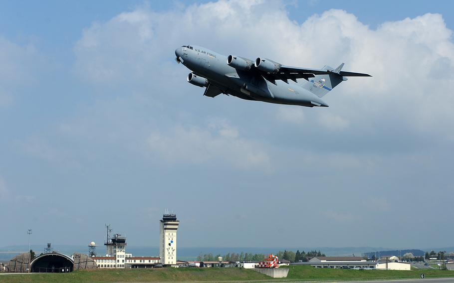 A C-17 Globemaster III takes off from Spangdahlem Air Base, Germany. President Trump is pushing a plan that would demand allies like Germany and Japan pick up the full cost of hosting U.S. troops in their countries, plus a 50 percent premium for American protection, according to a news report.