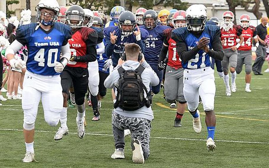 Players from Team USA, comprised of football players from 10 DODEA Pacific schools, make their way onto the field at Reid Memorial Stadium, Naval Air Facility Atsugi, Japan, March 10, 2019, for the eighth Tomodachi Bowl friendship game.