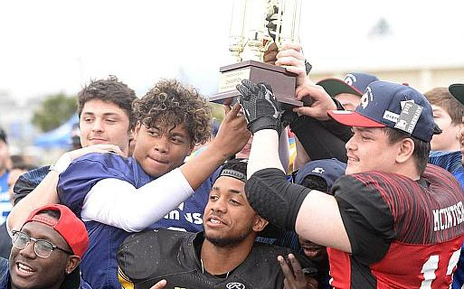 Team USA members pose with the Tomodachi Bowl trophy at Memorial Stadium, Naval Air Facility Atsugi, Japan, March 10, 2019.