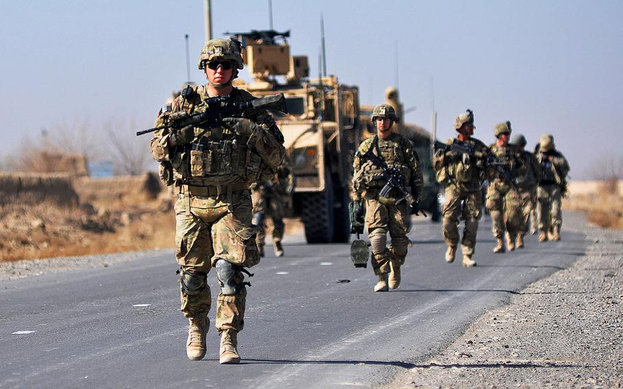 U.S. soldiers move toward a village near Forward Operating Base Zangabad in Kandahar province, Afghanistan, in 2013. The U. S. and the Taliban have drafted an agreement in principle on two of four core issues at the center of peace talks intended to end America's longest war.