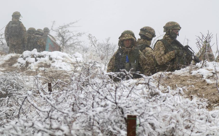 Georgian army soldiers stand watch in the middle of a snow fall during a combat exercise at Norio Training Area, Georgia, Nov. 15, 2018.