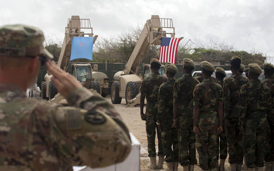 Somali national army soldiers stand in formation during a logistics course graduation ceremony in August 2018. Soldiers from Somalia's advanced infantry Danab battalion spent 14 weeks training with the U.S. 10th Mountain Division.
