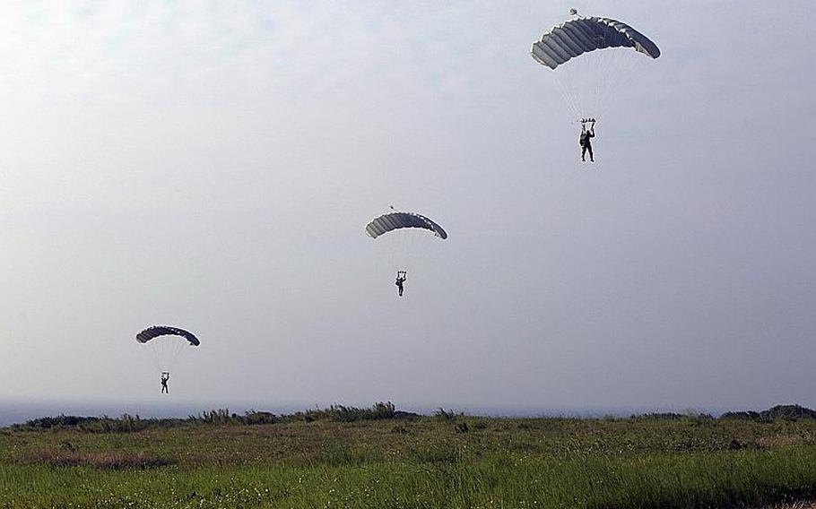 Members of the 31st Marine Expeditionary Unit parachute on Ie Shima during past training on the island off the west coast of Okinawa, Japan.