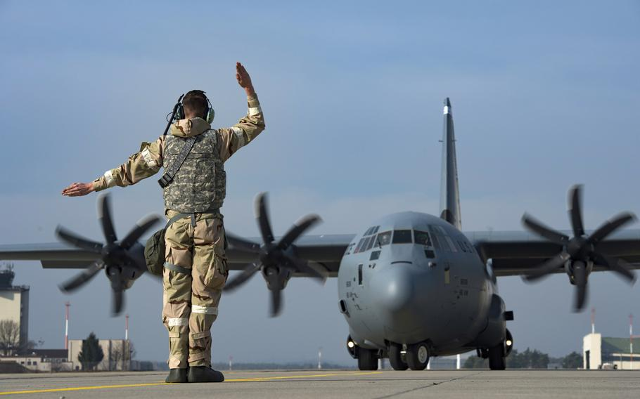 An 86th Aircraft Maintenance Squadron crew chief launches a C-130J Super Hercules aircraft at Ramstein Air Base, Germany, Feb. 28, 2019. Base officials say air operations have not been affected by a software glitch at Germany's air traffic control headquarters that forced the cancellation of several commercial flights at Frankfurt.