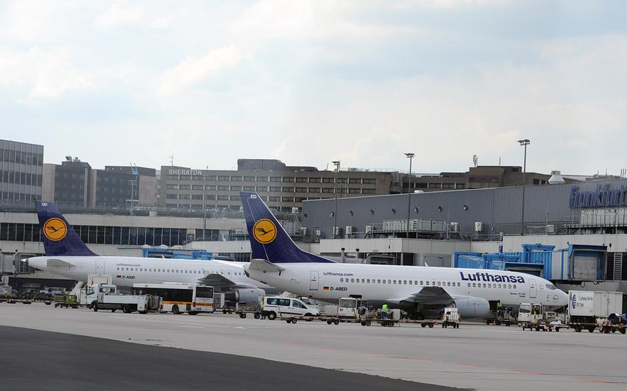 Lufthansa airplanes sit at the Frankfurt International Airport terminal. A software glitch at Germany's air traffic control headquarters forced Lufthansa to cancel more than 40 flights on Monday.