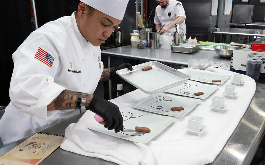 Staff Sgt. Erica Melendres, Team USA, plates a desert at the Joint Culinary Training Exercise at Fort Lee, Va., on March 13, 2019.
