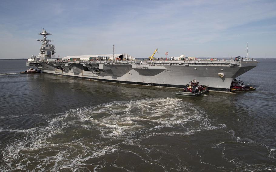 The USS Gerald R. Ford is maneuvered by tugboats in the James River during Ford's turn ship evolution, March 17, 2019. Fixing the aircraft carrier's nuclear propulsion system will cause a three-month in its joining the fleet.