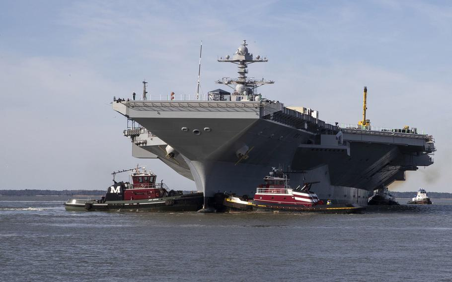 The USS Gerald R. Ford is maneuvered by tugboats in the James River during Ford's turn ship evolution, March 17, 2019. The aircraft carrier is currently undergoing its post-shakedown availability at Huntington Ingalls Industries-Newport News Shipbuilding.