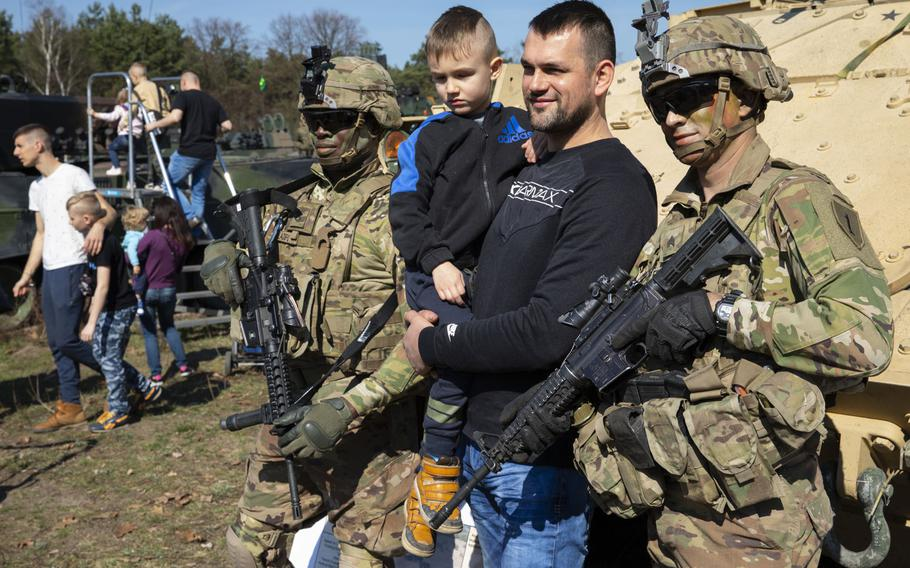 Soldiers from 1st Armored Brigade Combat Team, 1st Infantry Division pose with Polish locals during a commemoration the 75th anniversary of the Great Escape from the Stalag Luft III POW camp on March 23-24, 2019.
