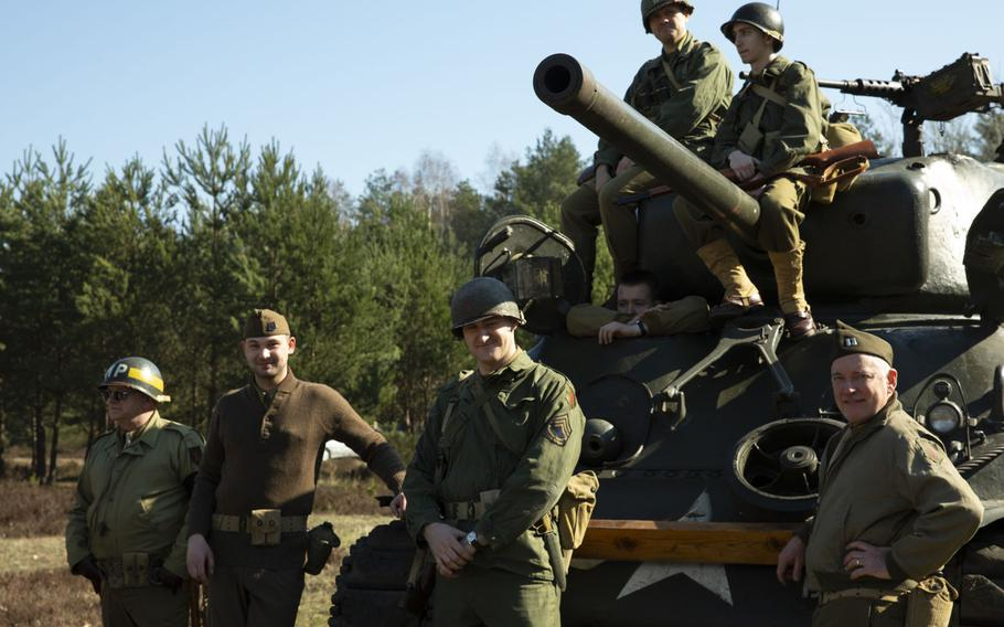 Polish WWII Big Red 1, 1st Infantry Division, re-enactors pose during a commemoration the 75th anniversary of the Great Escape from the Stalag Luft III POW camp on March 23-24, 2019.