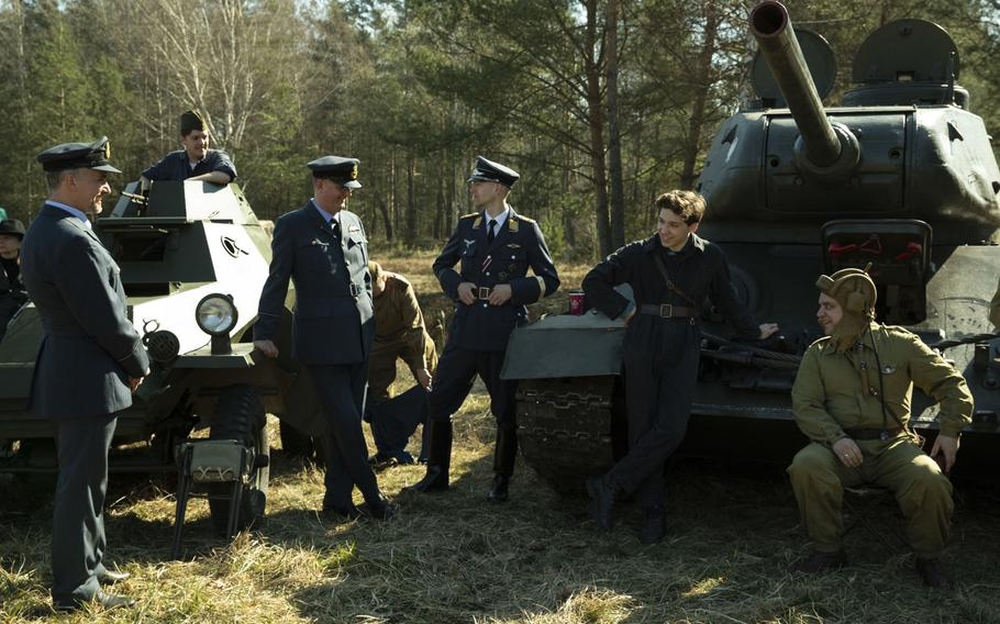 Polish WWII re-enactors perform during a commemoration event for the 75th anniversary of the Great Escape from the Stalag Luft III POW camp on March 23-24, 2019.