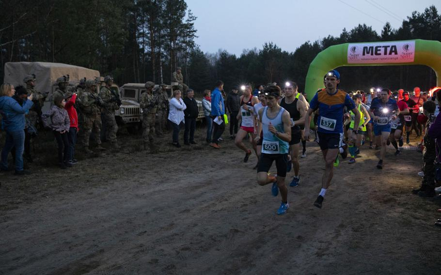 Soldiers from 1st Armored Brigade Combat Team, 1st Infantry Division and their Polish, civilian, partners joined for a 10K run during a commemoration event for the 75th anniversary of the Great Escape from the Stalag Luft III POW camp here on March 23-24, 2019.