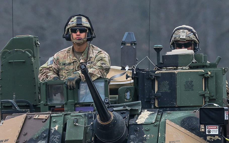 Capt. Kris Candelaria, commander Company C, 1st Battalion, 35th Armor Regiment, 2nd Armored Brigade Combat Team, 1st Armored Division out of Fort Bliss, Texas, arrives to the firing line in the Drawsko Pomorskie Training Area in a M2 Bradley on March 23, 2019.