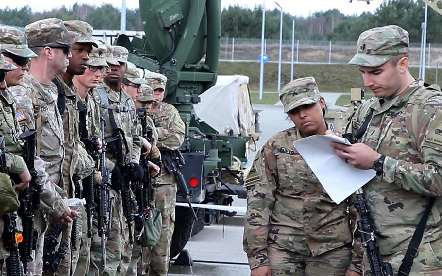 Soldiers with 1st Battalion, 35th Armor Regiment, 2nd Armored Brigade Combat Team, 1st Armored Division from Fort Bliss, Texas, check in for roll call after arriving at Drawsko Pomorskie Training Area, Poland, on March 19, 2019.