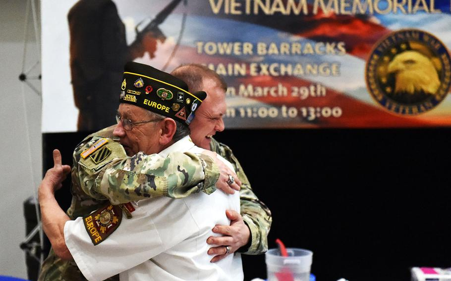 Sgt. Maj. Micheal Sutterfield (left) and George Quick, a Vietnam War veteran, embrace during a celebration to honor Vietnam War veterans, on Friday, March 29, 2019, at Grafenwoehr, Germany.