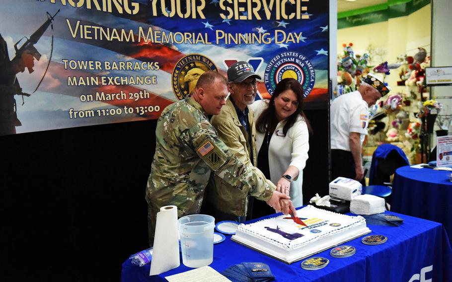 Sgt. Maj. Micheal Sutterfield (left), Eli Guerrero, a Vietnam War veteran, and Carrie Cammel, the general manager of the Grafenwoehr Exchange, cut the celebratory cake to honor Vietnam War veterans, on Friday, March 29, 2019, at Grafenwoehr, Germany.