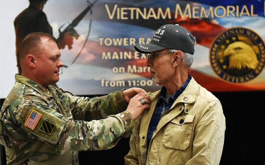 Sgt. Maj. Micheal Sutterfield pins a Vietnam War Veteran pin on to Eli Guerrero during a celebration to honor Vietnam War veterans, on Friday, March 29, 2019, at Grafenwoehr, Germany.