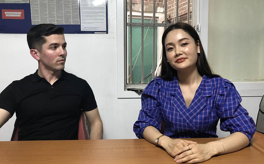 Army Capt. Matthew McGoffin listens to North Korean refugee Yuna Jung during an interview in Seoul, South Korea, March 27, 2019.