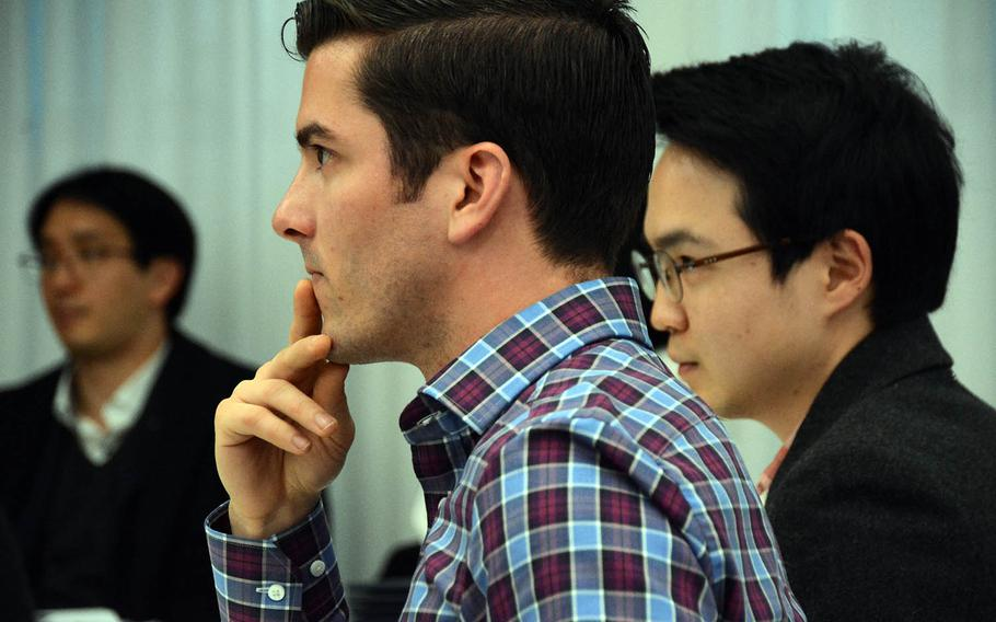 Army Capt. Matthew McGoffin watches closely as his student, North Korean refugee Yuna Jung, speaks during a speech contest organized by the nonprofit organization Teach North Korean Refugees in Seoul, South Korea, Feb. 23, 2019.