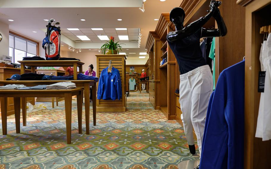 Employees stock merchandise at the pro shop inside the new River Bend Golf Course at Camp Humphreys, South Korea, March 27, 2019.