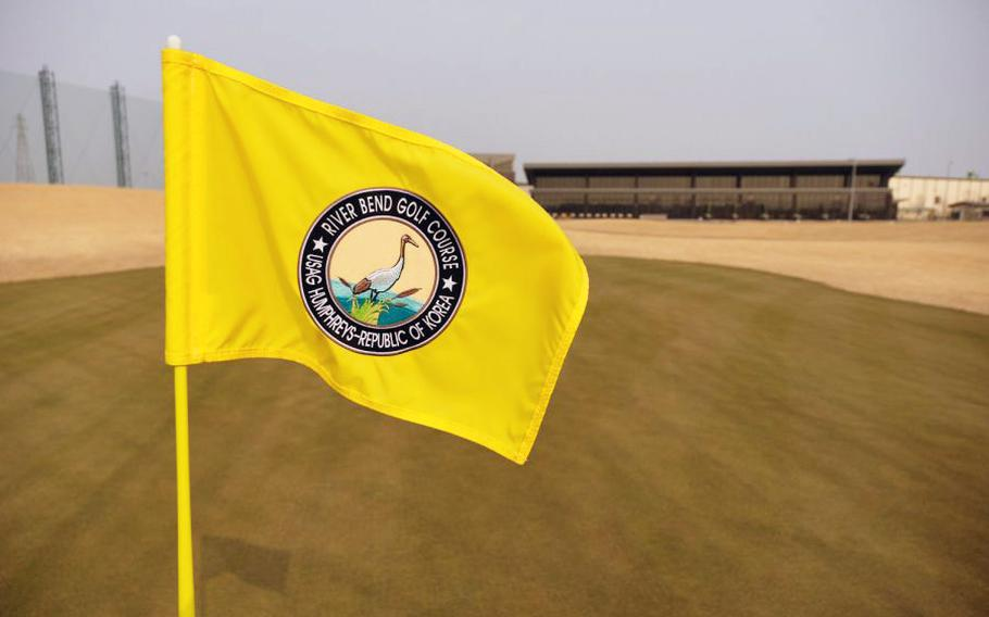 The pin flag at the 18th hole of the new River Bend Golf Course waves at Camp Humphreys, South Korea, March 27, 2019.