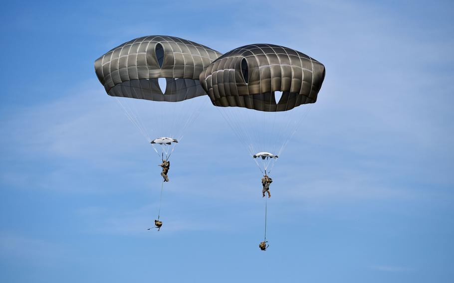 U.S. Army paratroopers assigned to 1st Battalion, 503rd Infantry Regiment, 173rd Airborne Brigade, descend onto Cerklje Drop Zone in Slovenia, March 22, 2019 after exiting from a U.S. Air Force C-130 Hercules during exercise Eagle Sokol.