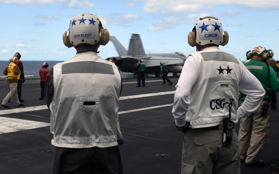 U.S. Second Fleet commander Vice Adm. Andrew Lewis, left, and Rear Adm. Gene Black, commander of  Carrier Strike Group Eight, observe flight operations aboard USS Harry. S Truman in the Atlantic Ocean in September 2018. The U.S. 2nd Fleet will lead the 47th annual exercise Baltic Operations this year.