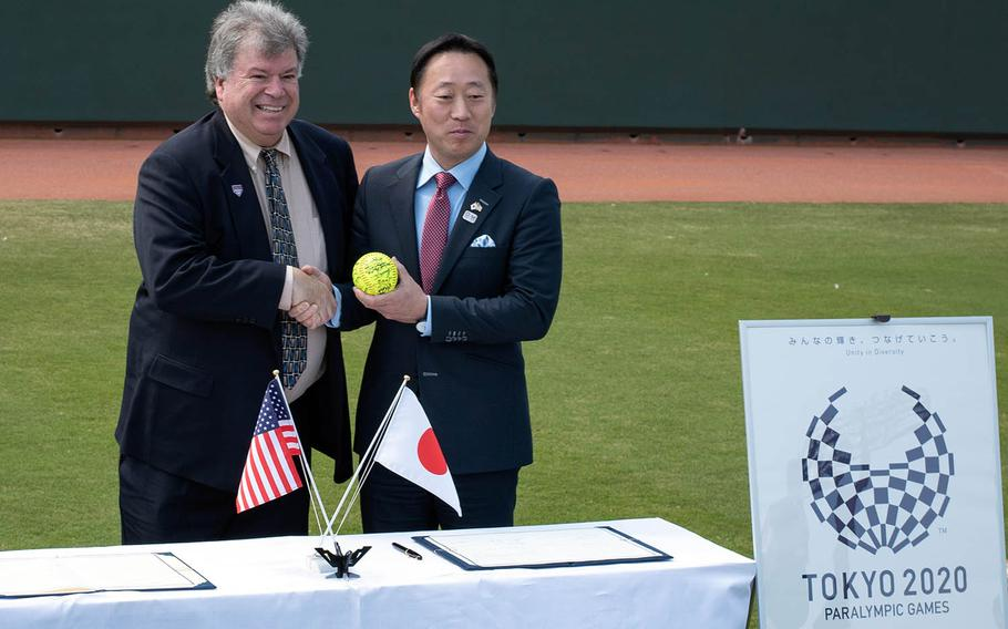USA Softball President John Gouveia, left, and Iwakuni City Mayor Yoshihiko Fukuda pose after signing an agreement for Team USA to use the city's Atago Sports Complex to practice for the 2020 Tokyo Olympics.