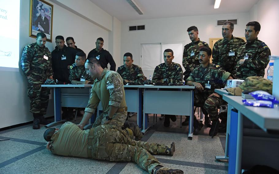 Maritime Enforcement Specialist 2nd Class Joe Kelly, a U.S. Coast Guardsman, demonstrates tactical combat casualty care during a training session at Phoenix Express on March 26, 2019.