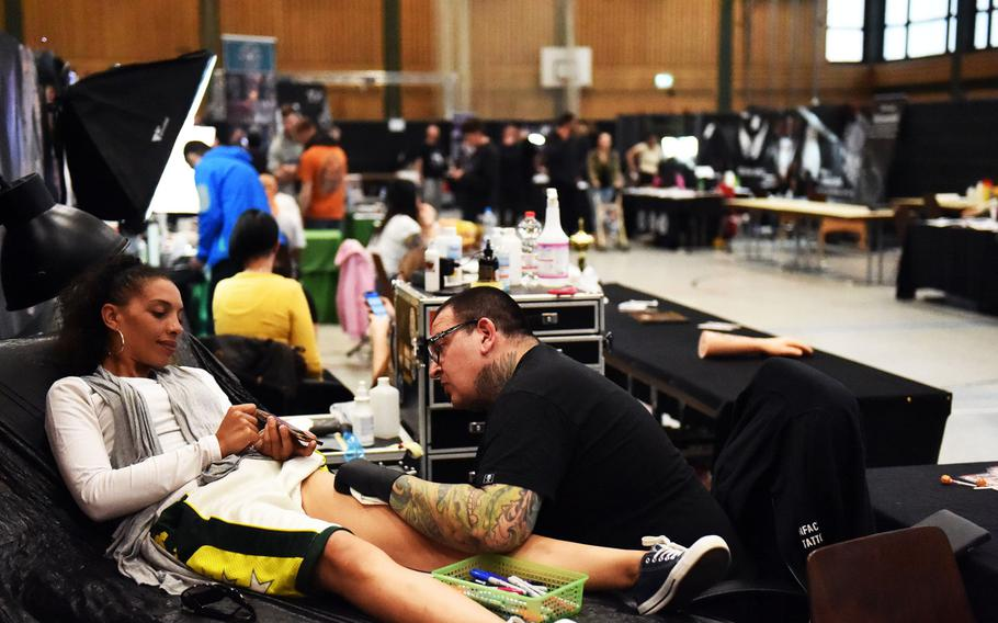U.S. soldiers and family members joining German citizens in getting tattooed at the Grafenwoehr Tattoo Expo, in Grafenwoehr, Germany, Sunday, April 8, 2019.