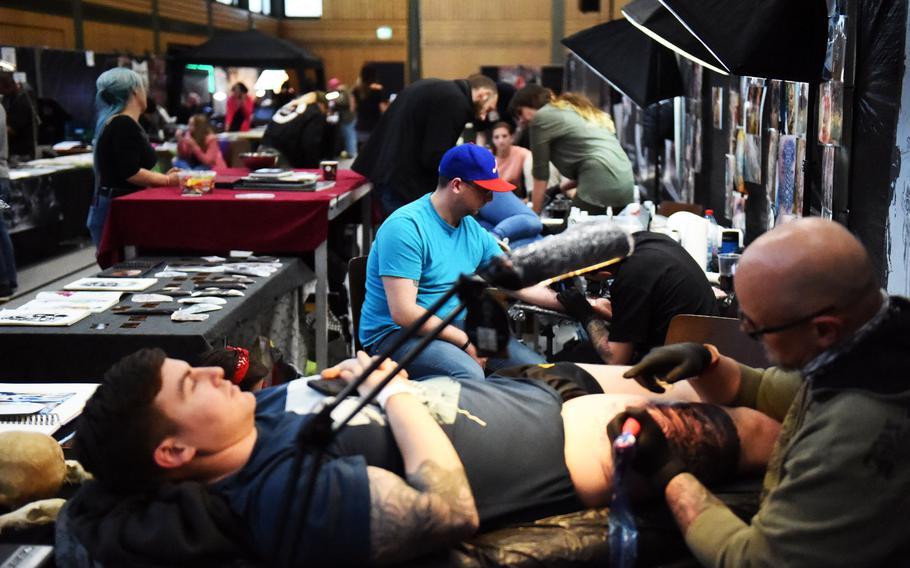 U.S. soldiers getting tattoed at the Grafenwoehr Tattoo Expo, in Grafenwoehr, Germany, Sunday, April 8, 2019.