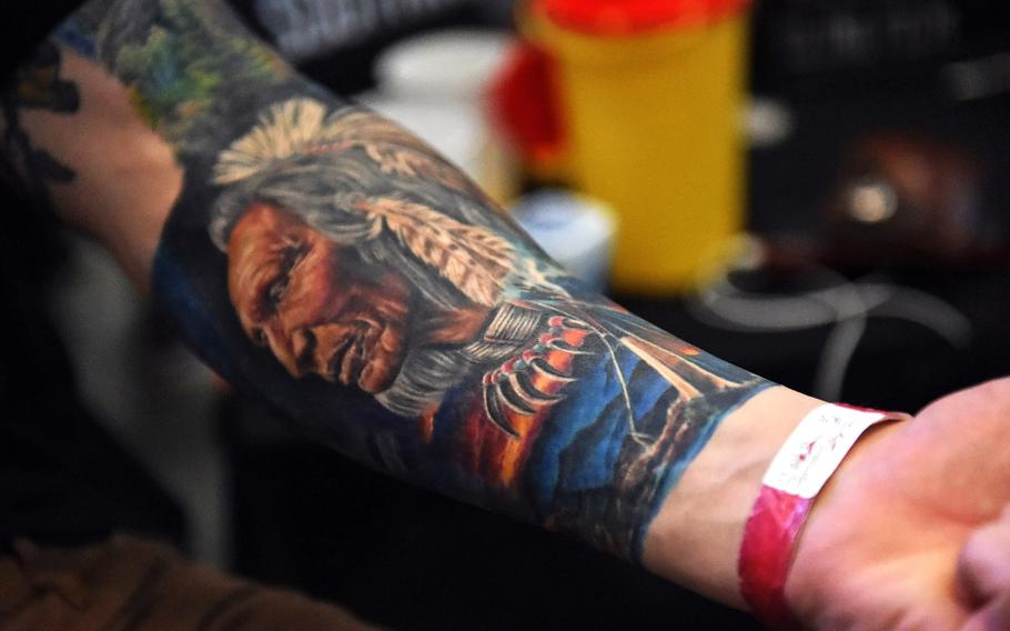 A soldier's Native American-themed tattoo at the Grafenwoehr Tattoo Expo, in Grafenwoehr, Germany, Sunday, April 8, 2019.