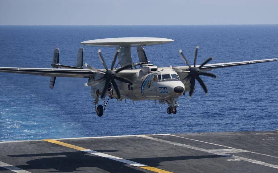 An E-2D Hawkeye from Carrier Airborne Early Warning Squadron 126 prepares to land on the flight deck of the USS Harry S. Truman, June 2018. The Navy awarded Northrop Grumman a $3.2-billion five-year contract modification to buy 24 E-2D Advanced Hawkeye airborne surveillance aircraft.