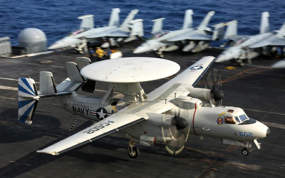 An E-2D Hawkeye performs an arrested landing on the flight deck of the aircraft carrier USS Abraham Lincoln in February 2019 in the Atlantic Ocean. The Navy awarded Northrop Grumman a $3.2-billion five-year contract modification to buy 24 E-2D Advanced Hawkeye airborne surveillance aircraft.
