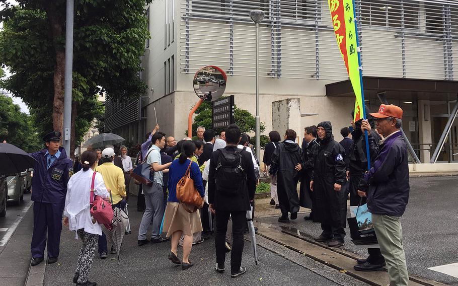 Okinawa residents who had sued over aircraft noise from Marine Corps Air Station Futenma walk toward Fukuoka High Court Naha Branch, Tuesday, April 16, 2019.