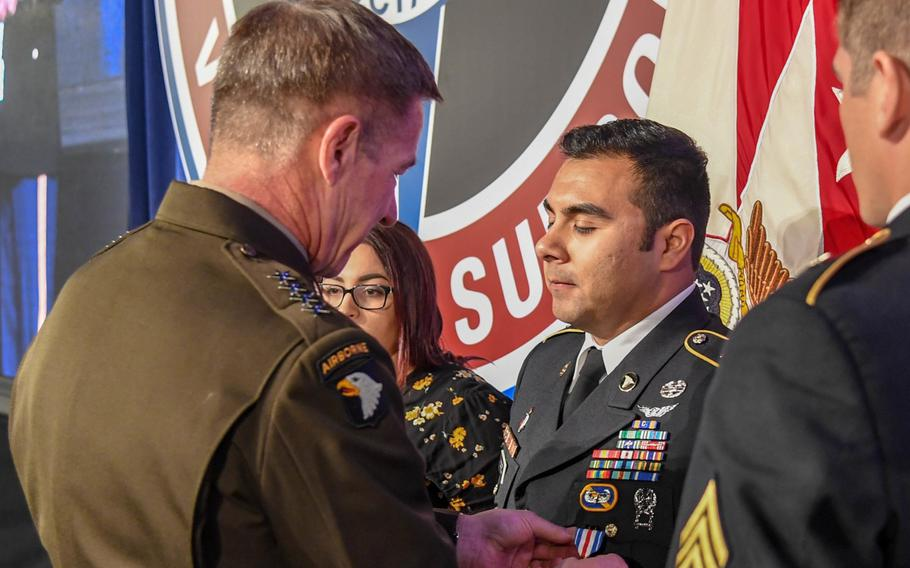 Gen. James McConville, Army vice chief of staff, presents the Silver Star to Sgt. Armando Yanez during a ceremony at the Army Aviation Association of America Summit 2019 in Nashville, Tenn., on Tuesday, April 16, 2019.