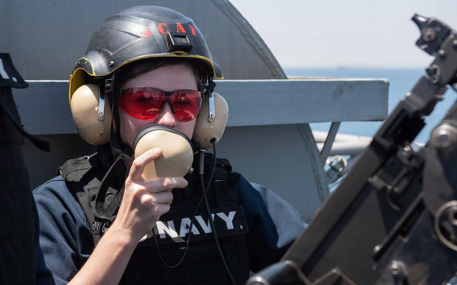 Seaman Emily Tate, an aviation ordnanceman from McKinney, Texas, uses a sound-powered phone while standing watch aboard the aircraft carrier USS John C. Stennis in the Suez Canal, April 20, 2019.