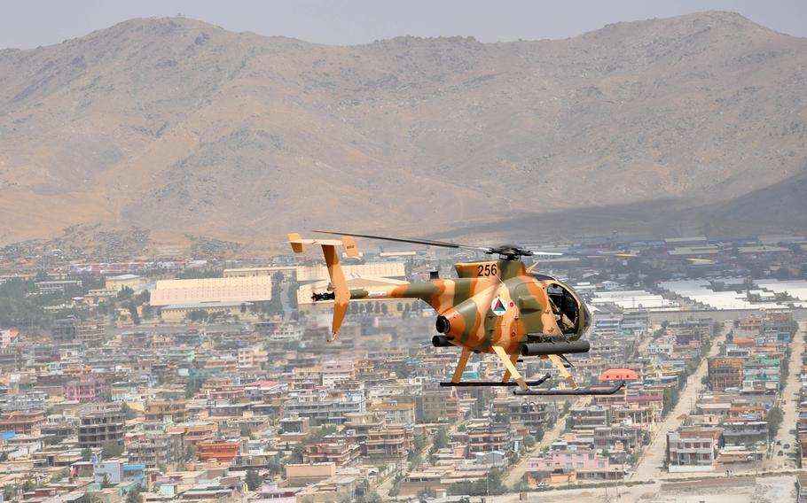 An Afghan MD-530 Cayuse Warrior attack helicopter flies over Kabul on Aug. 25, 2016. The United Nations has expressed concern over the number of civilians killed by Afghan and American airstrikes so far this year.