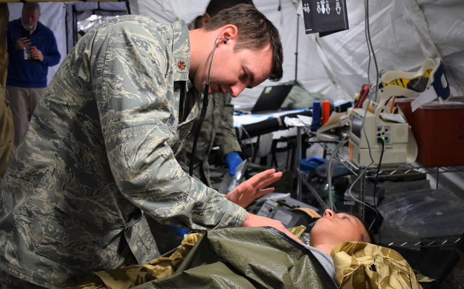 Maj. Jason Edwards, internal medicine specialist, 86th Medical Group, Ramstein Air Base, Germany, participates in a multinational medical exercise drill during Vigorous Warrior 19, Cincu Military Base, Romania, April 8, 2019.