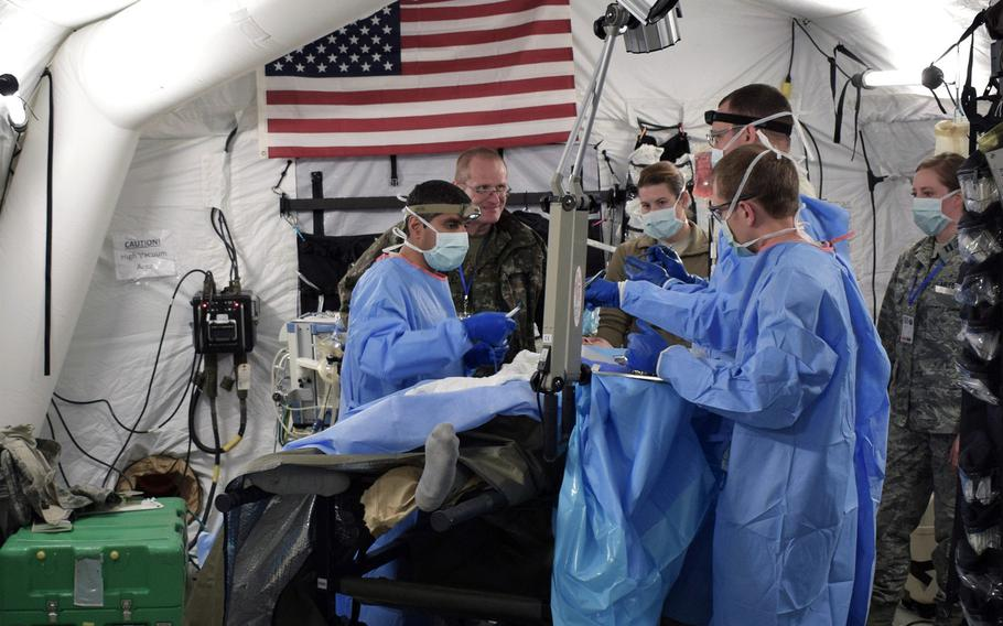 Airmen from the 86th Medical Group, Ramstein Air Base, Germany, participate in a multinational medical exercise drill during Vigorous Warrior 19, Cincu Military Base, Romania, April 8, 2019.