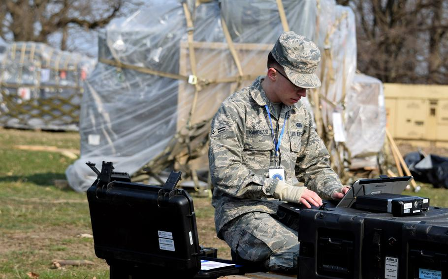 Airman 1st Class Harry Randazzo, 1st Combat Communications Squadron, Ramstein Air Base, Germany, prepares equipment for expeditionary medical support facilities at Cincu Military Base, Romania, April 4, 2019, during exercise Vigorous Warrior 19.