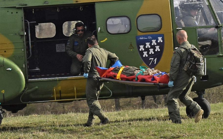 A Romanian aircrew performs a medical evacuation drill at the Role 2 field hospital maintained by airmen from the 86th Medical Group, Ramstein Air Base, Germany, during Vigorous Warrior 19, Cincu Military Base, Romania, April 8, 2019. Vigorous Warrior 19 is NATO's largest-ever military medical exercise.
