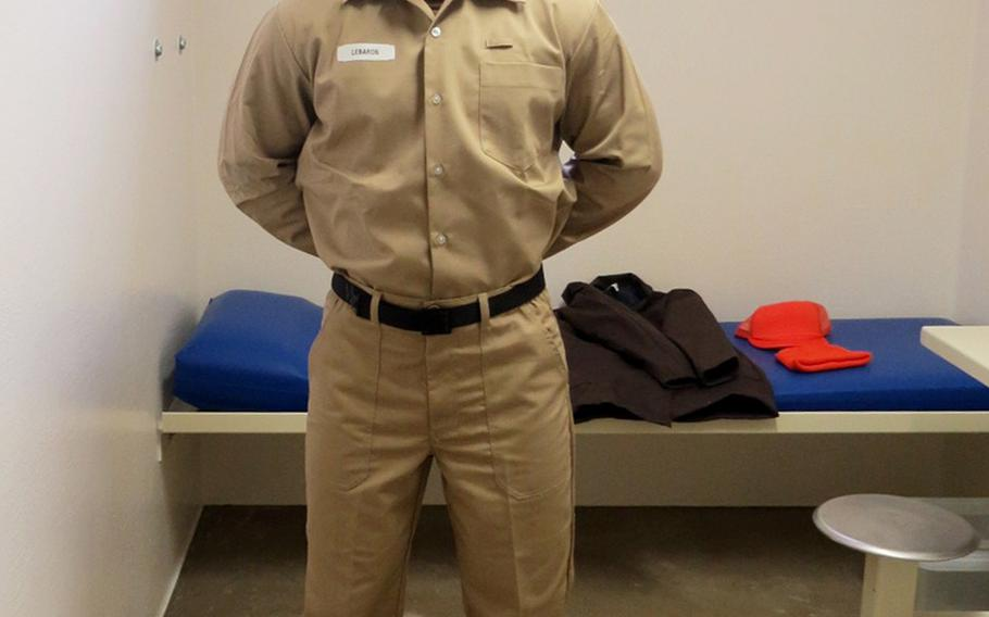 A sailor models the Navy's new post-trial standardized prisoner uniform, which will be mandatory for all prisoners beginning Wednesday, May 1, 2019.